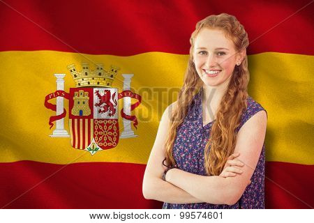 Casual woman smiling against digitally generated spanish national flag