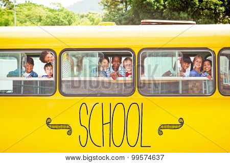 The word school against cute pupils smiling at camera in the school bus
