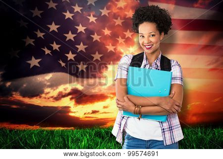 Casual young woman with folder in office against composite image of united states of america flag