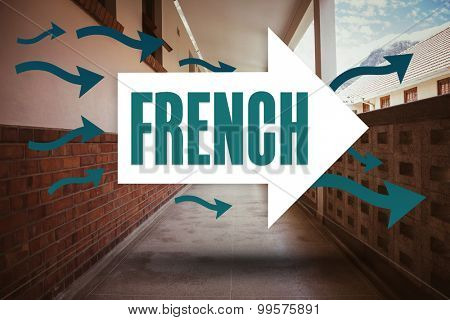 The word french and arrows against empty hallway