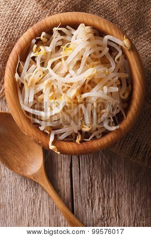 Raw Sprouts Of Mung Beans In A Wooden Bowl. Vertical Top View