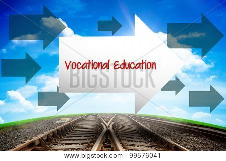 The word vocational education and arrow against railway leading to blue sky