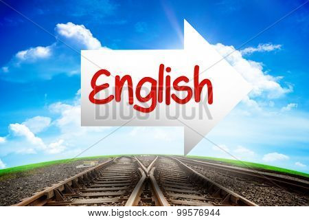The word english and arrow against railway leading to blue sky