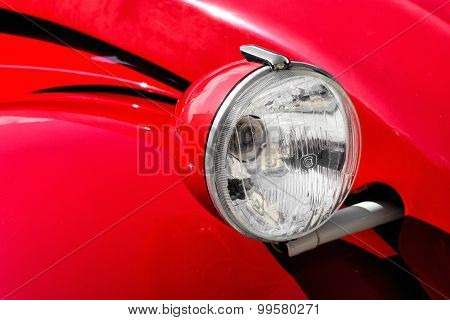 Front Headlight On A Red Vintage Car