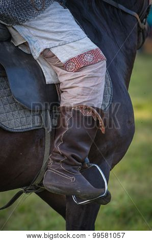 Horse rider leg boot saddle leather details closeup