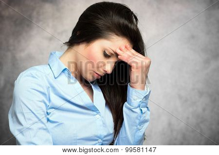 Stressed woman having a strong headache