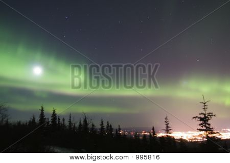 Full Moon And Active Colorful Aurora Over Fairbanks Alaska