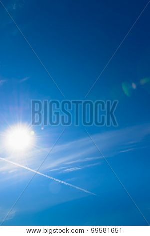 Sun and sky with lens flare background