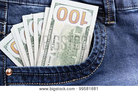 100 dollar bills money in pocket of blue jeans