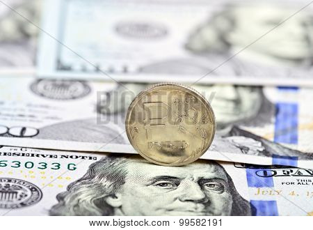 coin one ruble against the background US dollars