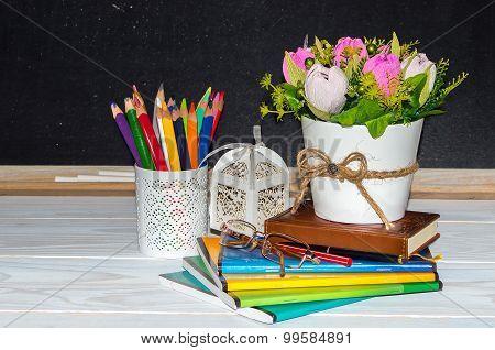 Teacher  Day. Flowers And Gift; Copybooks On The Teacher's Desk.