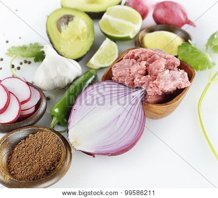 Cooking Ingredients with Ground Beef and Vegetables
