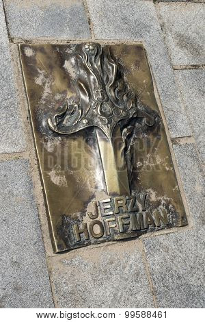 MIEDZYZDROJE, POLAND - AUGUST 16: The memorial plaque in brass on a sidewalk of famed Polish movie director Jerzy Hoffman at