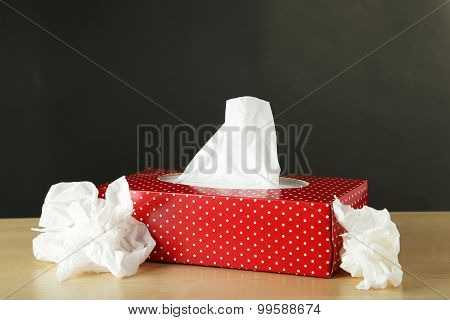 Cleaning Wipes On Brown Wooden Background