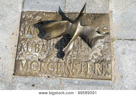 MIEDZYZDROJE, POLAND - AUGUST 16: The memorial plaque in brass on a sidewalk of famed Polish movie director Janusz Morgenstern at