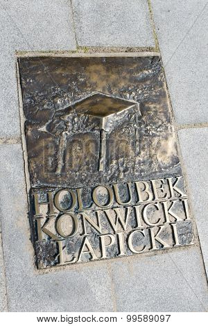 MIEDZYZDROJE, POLAND - AUGUST 16: Bronze plaque on a sidewalk of famed Polish movie stars and scenarist Lapicki, Holoubek, Konwicki at