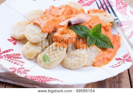 gnocchi with tomato sauce and basil on a tablecloth