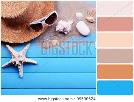 Travel accessories on wooden background and palette of colors