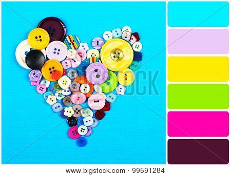 Sewing buttons heart on cloth background and palette of colors