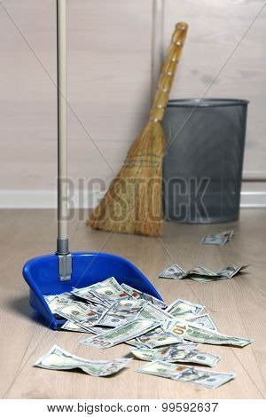Dollars in garbage scoop in room