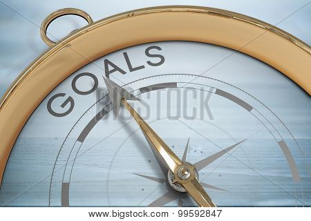 Compass pointing to goals against bleached wooden planks background
