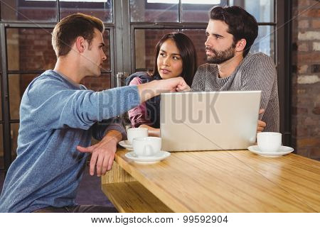 Group of friends enjoying a coffee in a cafe