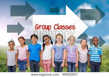 The word group classes and cute pupils smiling at camera in classroom against sunny landscape