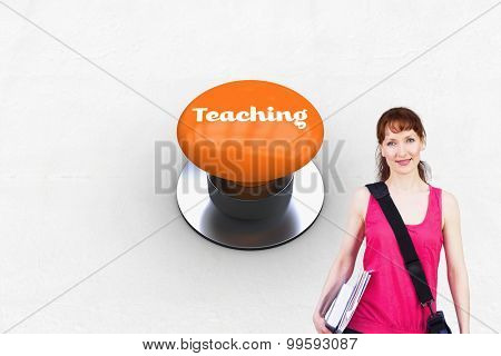 The word teaching and woman holding her school notebooks against orange push button