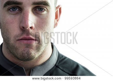 Tough rugby player looking at camera on white background