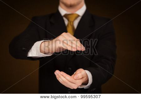 Businessman holding something in front of his body