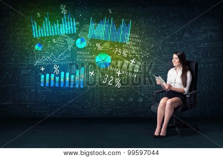Businesswoman in office with tablet in hand and high tech graph charts concept on background