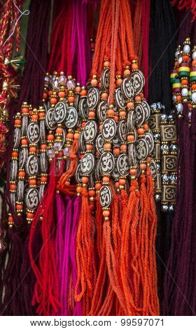 Religious Hindu wrist bands with 'Aum' sign, displayed in the shop.