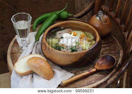 Stewed Meat With A Potato, Vegetables And Greens And Vodka In A Transparent Wine-glass