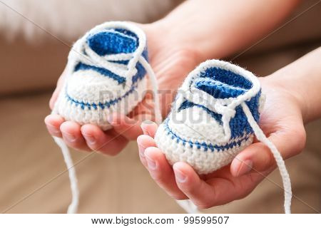Little Baby Shoes. Handknitted First Sneakers For Boy. Crochet Handmade Bootees In Daddy's Hands.
