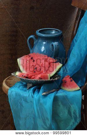 Dark Blue Ceramic Jug And Ripe Water-melon On A Copper Dish