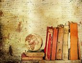 Vintage background with old books. Back to school concept                                poster