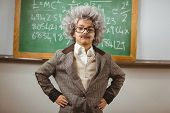 Portrait of little Einstein posing in front of chalkboard in a classroom poster