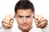 Young Businessman Holding Glasses
