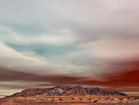 picture of ore lead  - Colorful sky above Arizona desert mountain ravaged by mining - JPG
