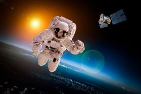 foto of outer  - Astronaut in outer space against the backdrop of the planet earth - JPG