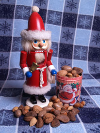 image of tchaikovsky  - an old german santa claus nutcracker with some mixed nuts ready for cracking - JPG