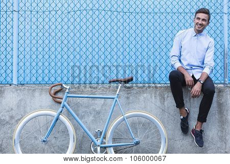 Handsome Businessman With Bike