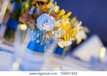 Elegant Banquet Table Prepared For Conference Or Party And Decorated Flowers For Guests.