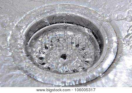 Water Flowing Down In The Hole In A Kitchen Sink
