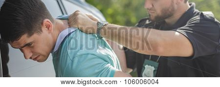 Policeman Arresting Man