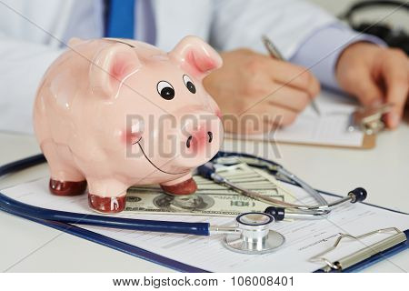 Funny Piggybank With Document On Clipboard