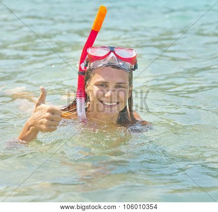 Woman With A Mask For Snorkeling In Sea Water