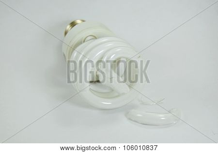 broken fluorescent lamp on white background
