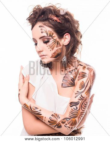 Portrait of beautiful lady with bodyart