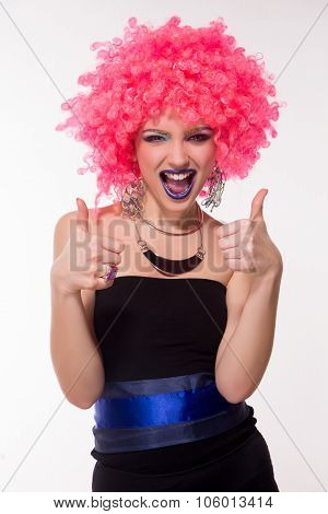 Portrait of beautiful party girl in pink wig